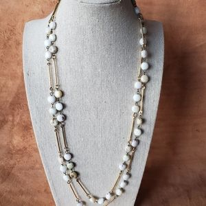 One continuous strand stone and gold necklace